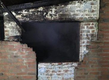 Пламя уже вырывалось из окон дома по улице Социалистической
